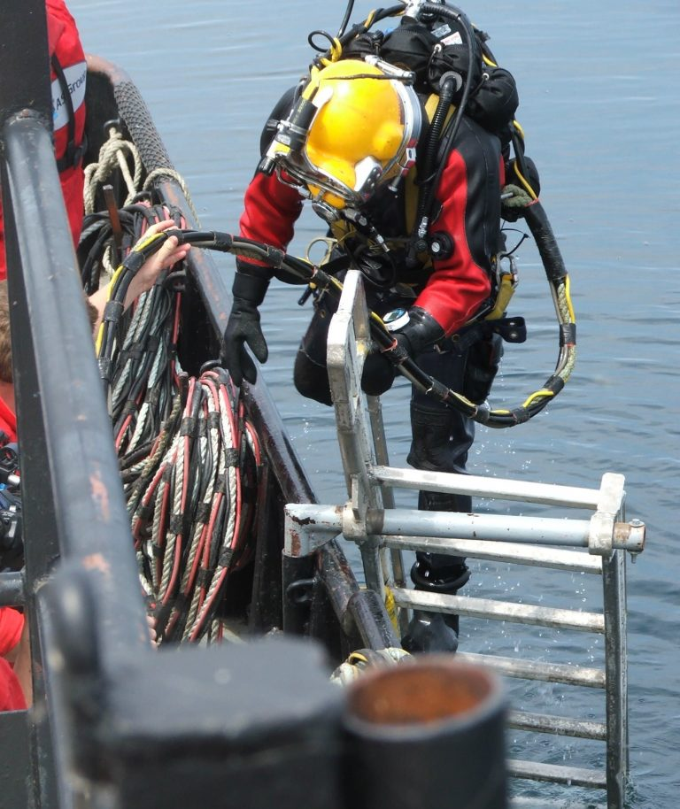 A commercial diver entering the water